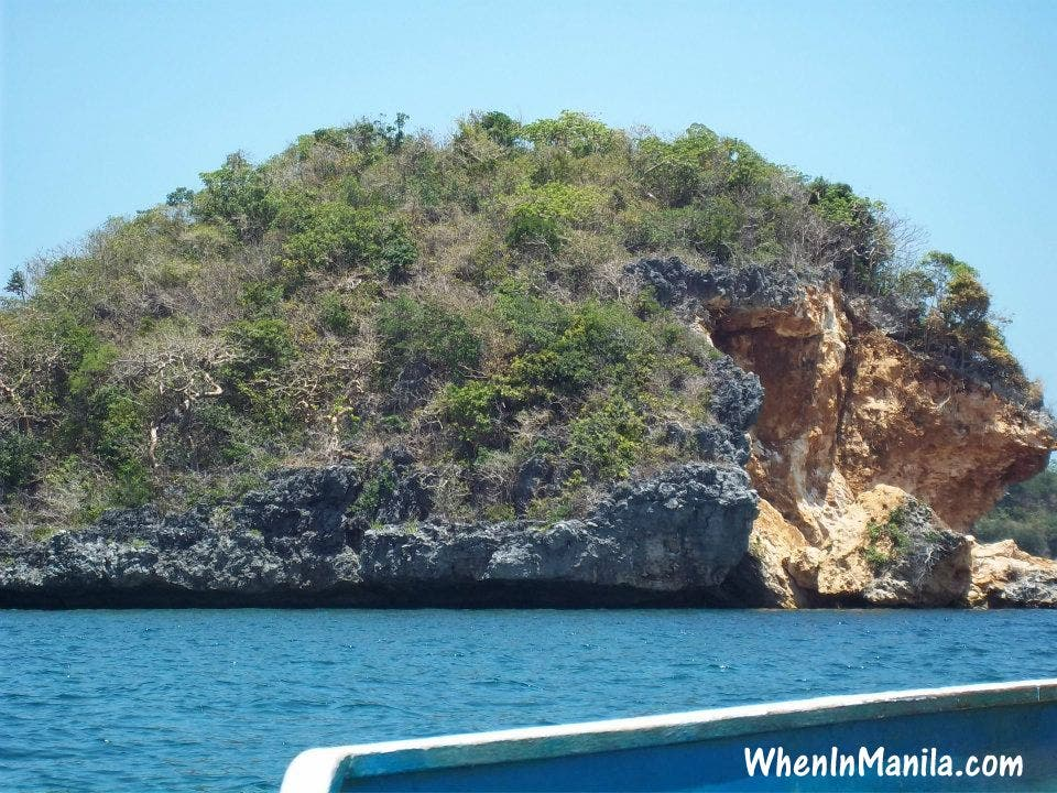This island looked as though somebody with a giant chisel cut off a chunk from it