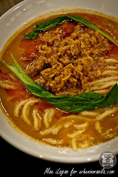 Tan Tan Ramen Reg. 280php / Large 320php Light a fire in your taste buds with this ramen in a reddish, spicy chilli and sesame soup, garnished with chopped scallion and chili.