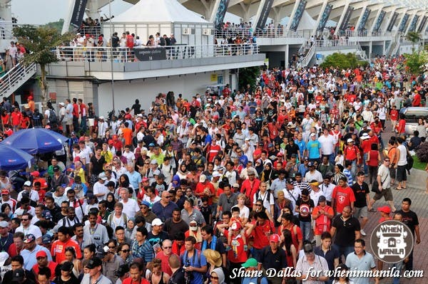 Fans leave the Malaysian Grand Prix after an exciting day.