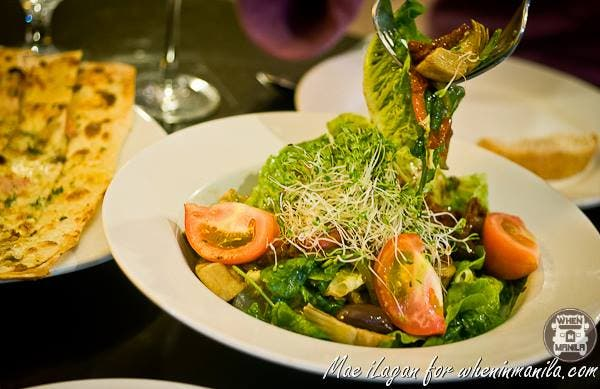 OASIS SALAD a blend of artichokes hearts, roasted peppers, capers, caramelized onion, sun dried tomatoes, kalamata olives, arugula and romaine letus Php 540.00