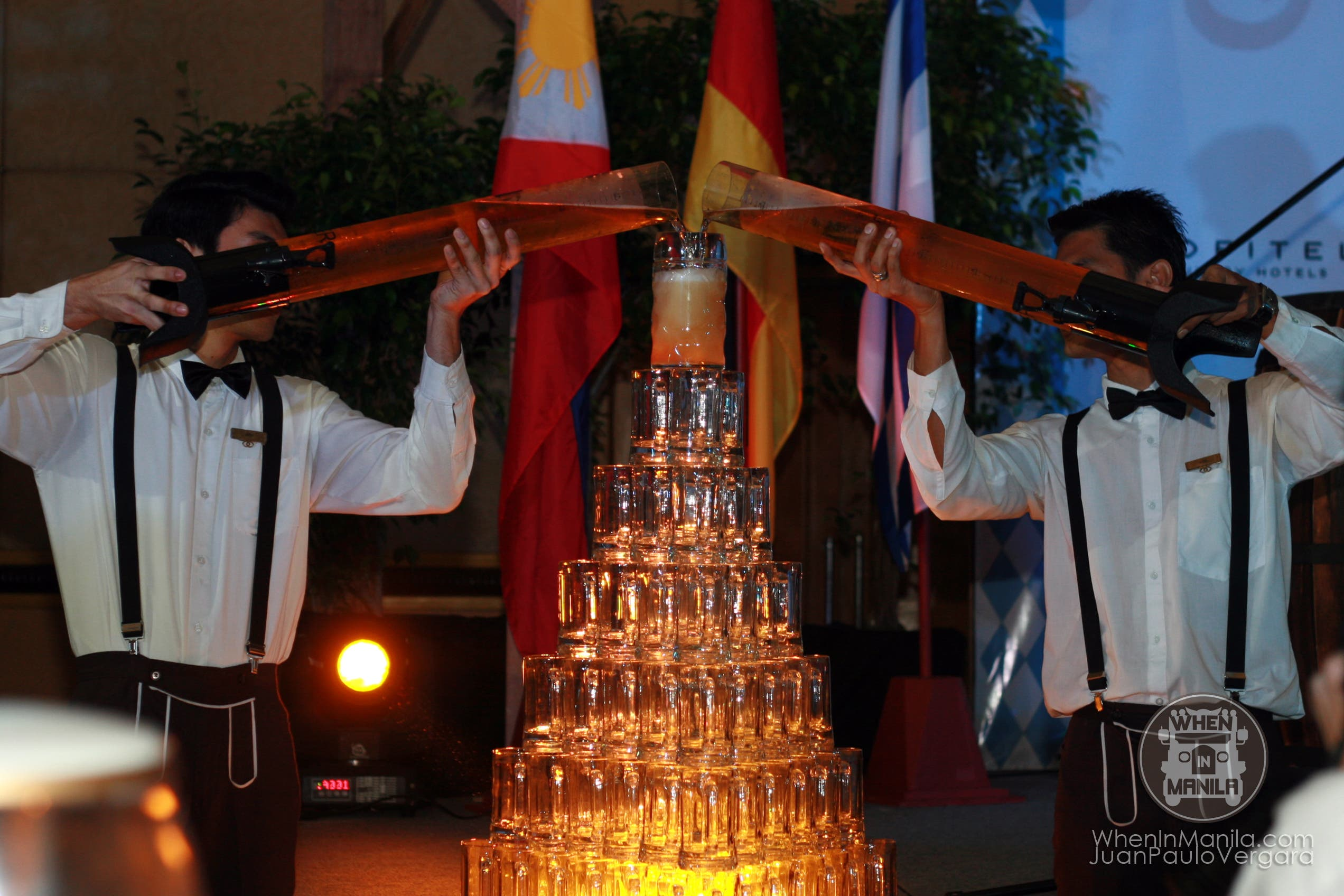 Oktoberfest Manila 2013 pouring of beer over tower of glass
