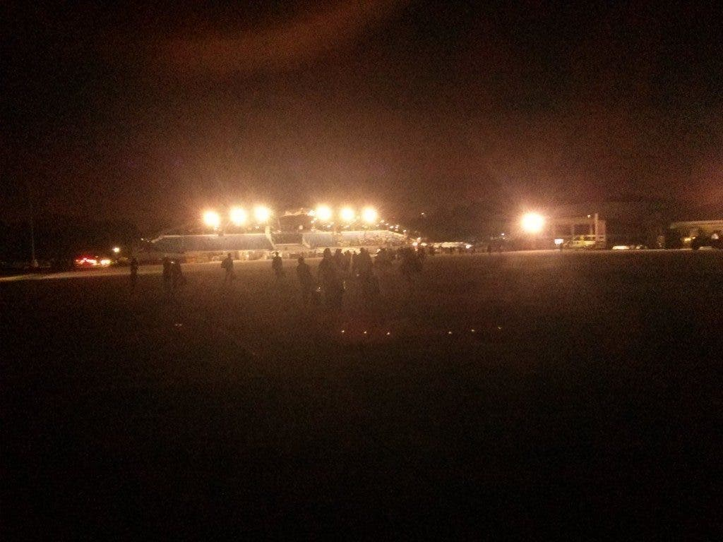 This is what they see as they exit the plane: the lights of the grandstand, where they will wait to leave after going through medical.