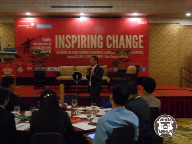 Coach Chot striding during his talk