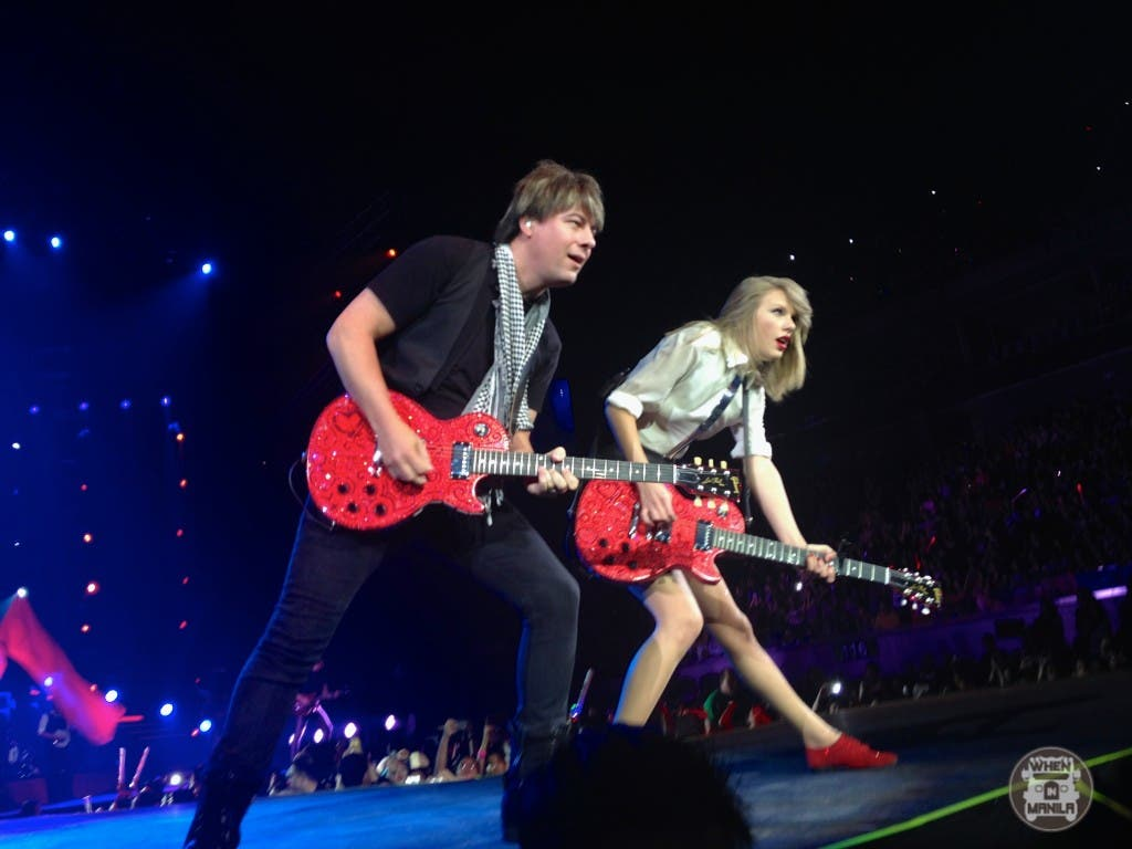 Performing Red with her electric guitar