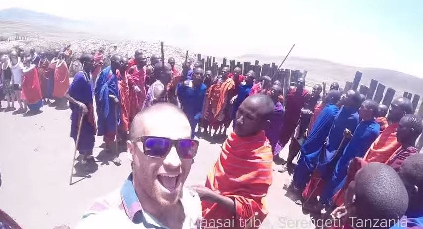 Guy Quits His Job To Travel the World and Give High Fives