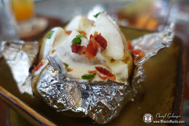 Baked Potato topped with Sour Cream and Bacon bits.