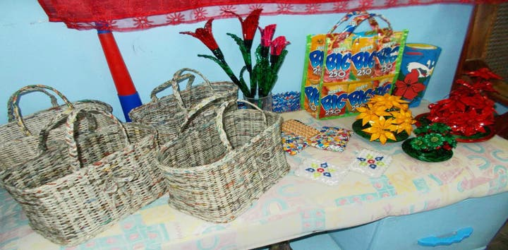 Finished bags, wallets, and flowers from recycled materials made by the SCYO students. Photo courtesy of the SCYO.