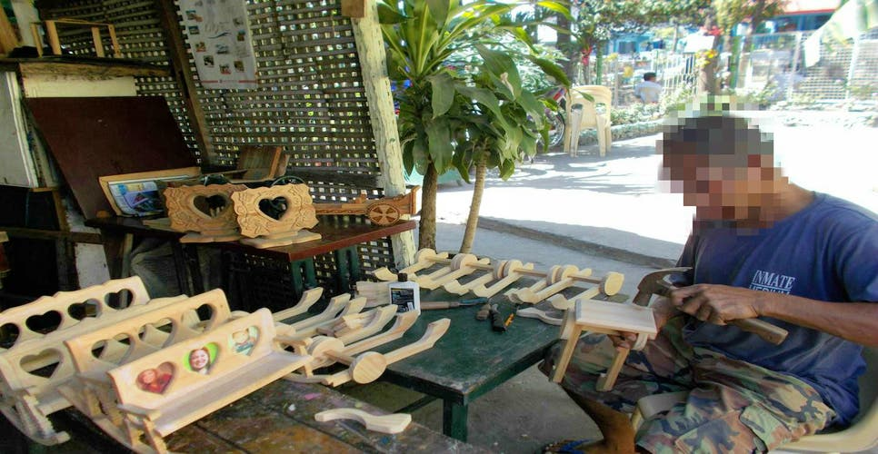 An inmate SYCO teacher shows how wood product handicrafts are made. Photo courtesy of the SCYO.