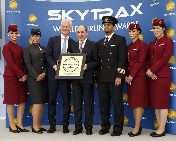Lord Paul Deighton, Chairman of Heathrow Airport presents Qatar Airways Group Chief Executive, His Excellency Mr. Akbar Al Baker with the World's Best Business Class accolade
