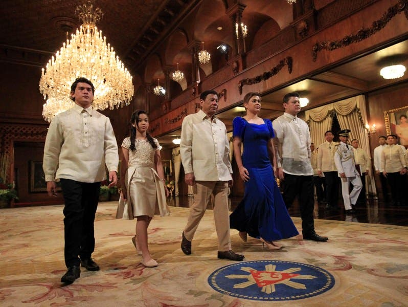 President-elect Rodrigo Roa Duterte arrives at the Rizal Hall of Malacañan Palace, where the inaugural ceremony will take place, together with his children Paulo, Sara, Sebastian and Veronica.