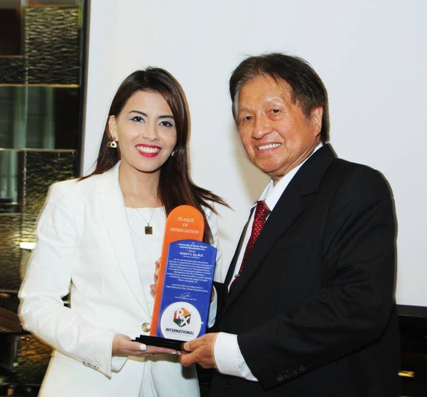 RX International Events and Marketing Consultancy Company CEO Xiameer Valdeavilla presents a plaque of gratitude to her business partner and mentor Dr. Robert Sy.