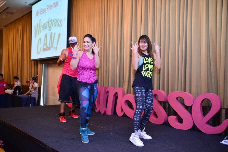Celebrity mom and certified zumba instructor Regine Tolentino and Chin Sonesing with Sante Impact System Fitness Instructor Zin Chen Rojas