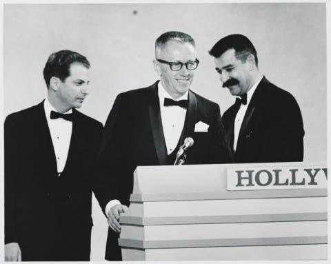 Mendelson, Schulz, and Melendez accepting an Emmy Award for A Charlie Brown Christmas