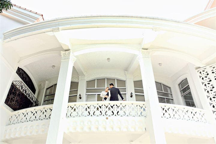 J. Couple at the Mansion's Balcony