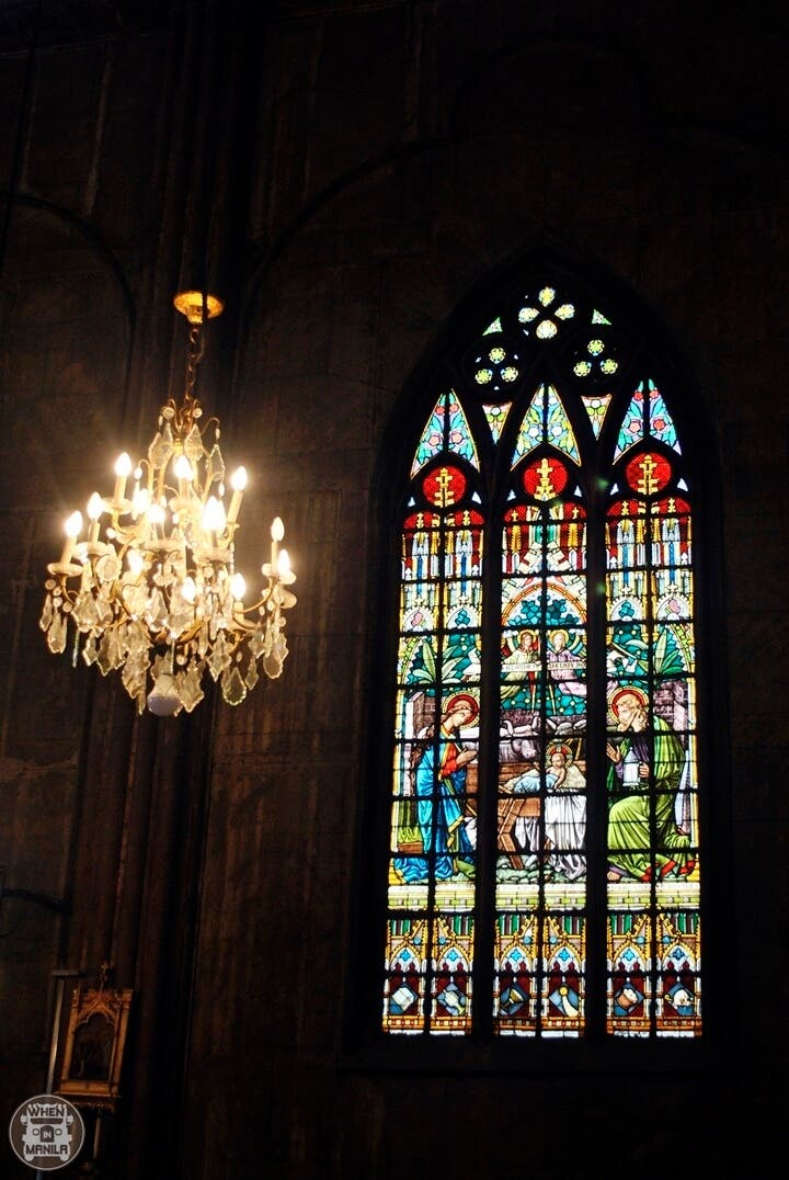 san sebastian basilica stained glass window and chandelier