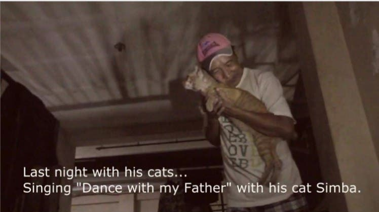 Lolo Rex with Simba, his beloved cat