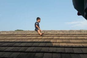 Boy hides on roof to avoid circumcision