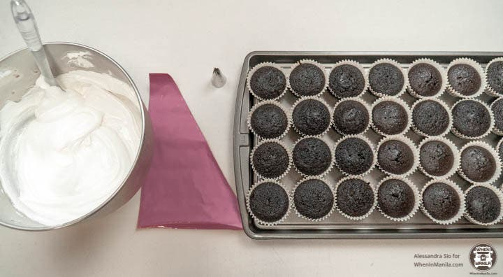 icing tray of cupcakes